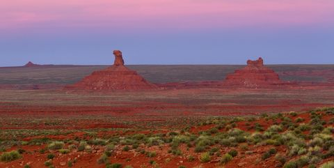 Sky, Butte, Red, Natural landscape, Landmark, Atmospheric phenomenon, Morning, Ecoregion, Sunset, Badlands,