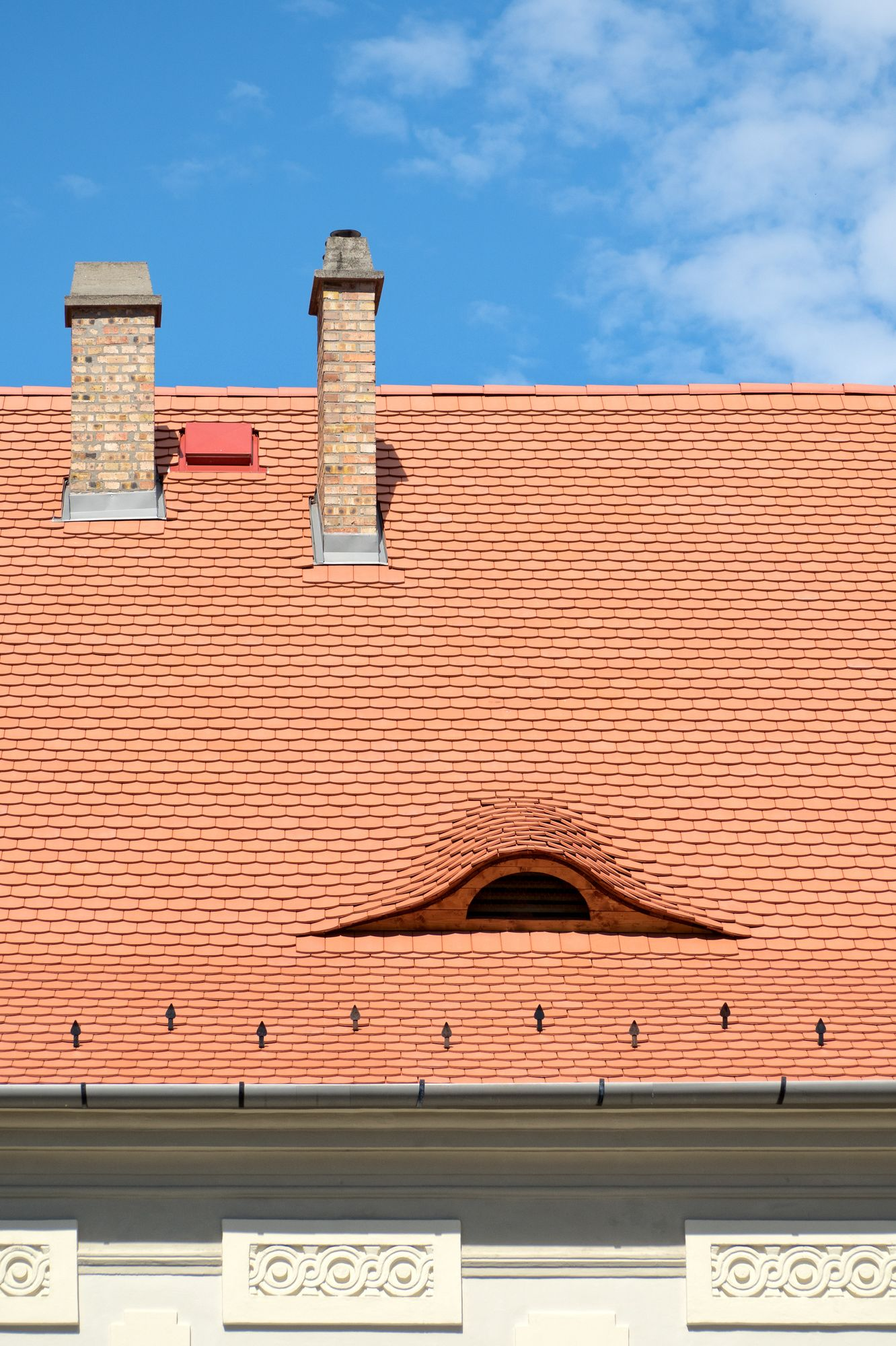 Eye shaped window in a tiled roof of Budapest