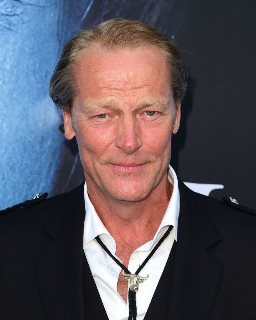 Iain Glen (without beard) Bearded rugged Glen somehow looks younger.