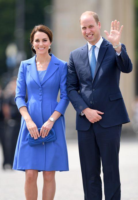 Cobalt blue, Suit, Clothing, Blue, Formal wear, Electric blue, Uniform, Fashion, Standing, White-collar worker,