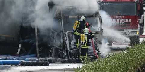 Smoke, Vehicle, Firefighter, Emergency, Fire department, Auto part, Steam, Explosion, Asphalt, Emergency service,