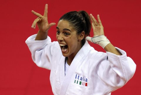 italys giulia quintavalle celebrates on the podium before receiving her gold medal for the womens  57kg of the 2008 beijing olympic games on august 11, 2008 in beijing italy giulia quintavalle won the judo final against netherlands deborah gravenstijn     afp photo  olivier morin photo credit should read olivier morinafp via getty images