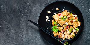 Stir fried tofu, cashew, chili. Copy space, top view