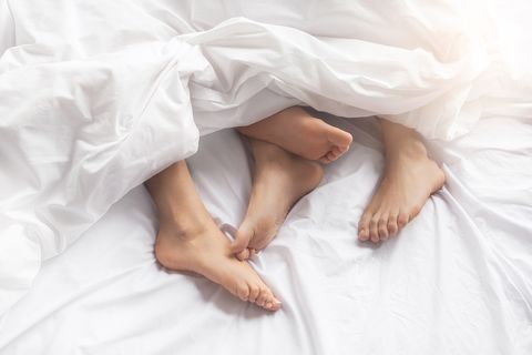 White, Leg, Skin, Arm, Hand, Barefoot, Bed sheet, Textile, Photography, Linens,