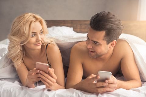 Young couple intimate relationship on bed technology