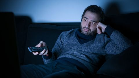 Blue, Facial hair, Fun, Sitting, Darkness, Beard, Technology, Room, Electronic device, Mouth,