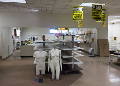 "empty shopping racks and mannequins being sold at discount prices are displayed at the jcpenney at the columbia mall on july 24, 2017 in bloomsburg, pennsylvania the jcpenney is having a store liquidation sale and plans to close july 31, 2017 abandoned by the big brands, deserted by the young, the american mall, once temples of the shopping, have become ghost towns, victims of the explosion of online shopping   afp photo  don emmert  to go with afp story by john biers, ""deserted, us shopping centers look for a future""        photo credit should read don emmertafp via getty images"
