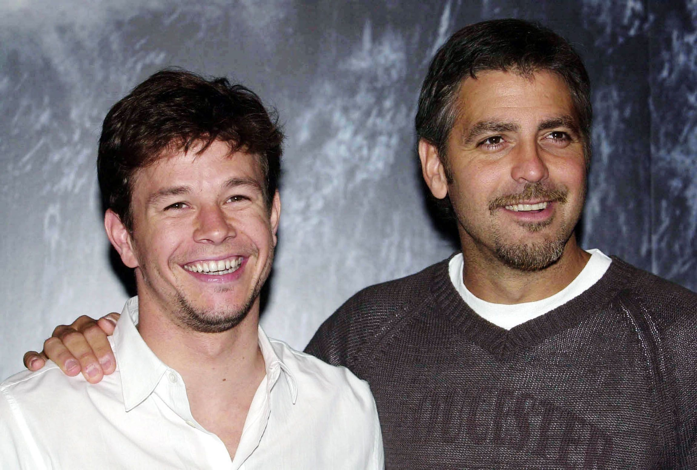 Mark Wahlberg and Clooney attending the UK premiere of The Perfect Storm , at the Warner Village cinemas, Star City, Birmingham.