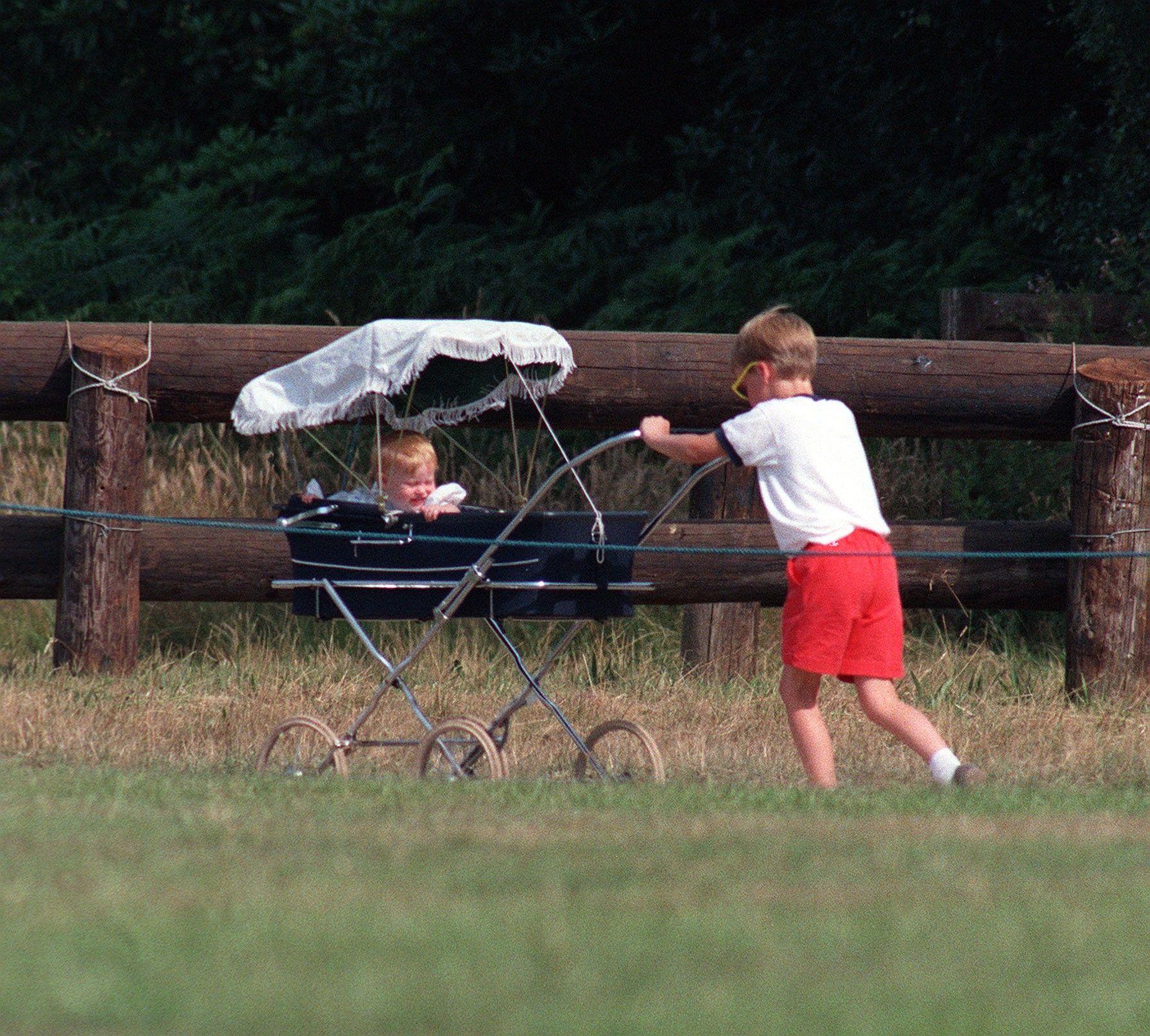 Prince William pushing pram