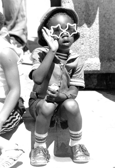jun 18 1989, juneteenth celebration 24th and welson javhon walker age 3 waves at passing parade denver post via getty images