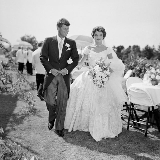 a scene from the kennedy bouvier wedding groom john walks alongside his bride jacqueline at an outdoor reception, 1953 newport, rhode island photo by bachrachgetty images