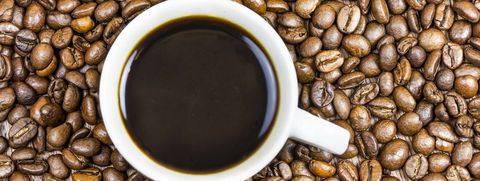 Cup coffee with coffee beans