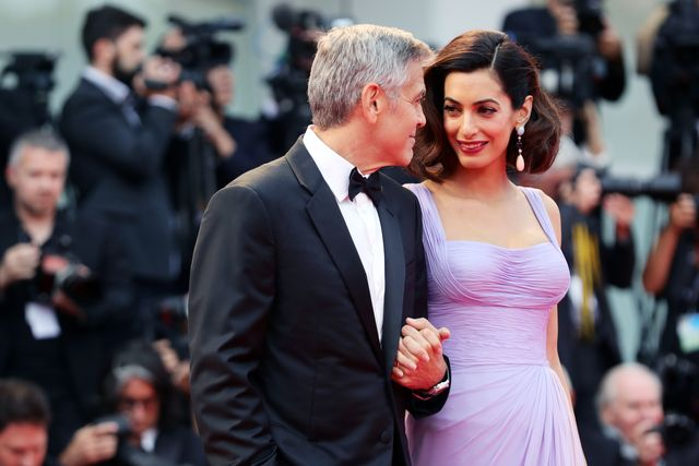 venice, italy   september 02  george clooney and amal clooney walk the red carpet ahead of the suburbicon screening during the 74th venice film festival at sala grande on september 2, 2017 in venice, italy  photo by vittorio zunino celottogetty images