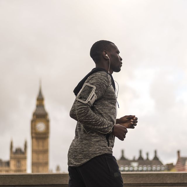 active young african american man jogging in london