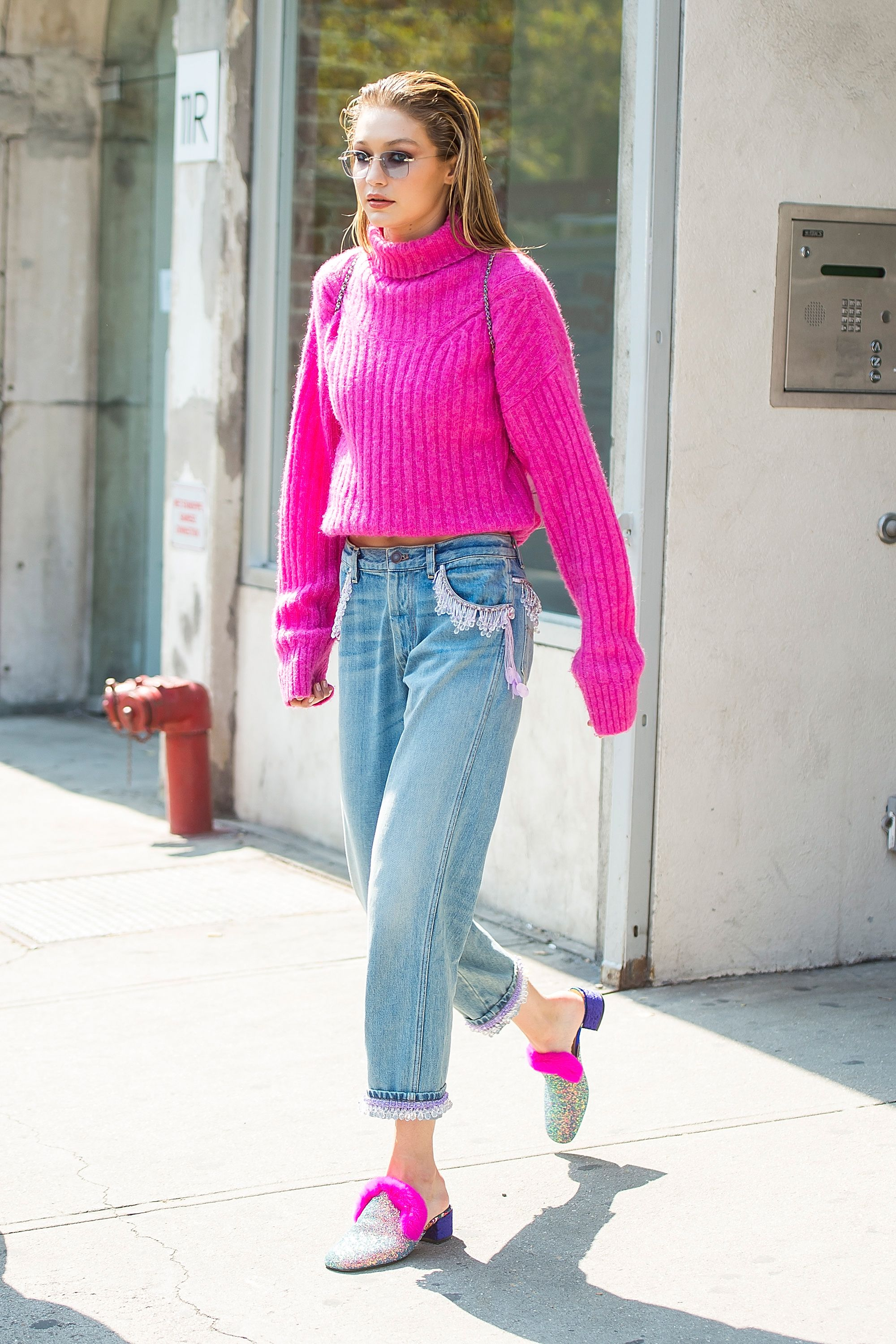 September 11, 2017 During New York Fashion Week, Hadid was spotted in a magenta turtleneck sweater from 3.1 Phillip Lim and Marc Jacobs jeans. The furry trim on her Christian Louboutin mules matched her sweater perfectly.