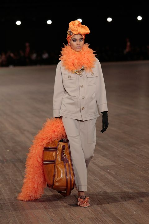 Fashion, Orange, Runway, Fashion show, Human, Fashion design, Event, Fur, Performance, Performance art,