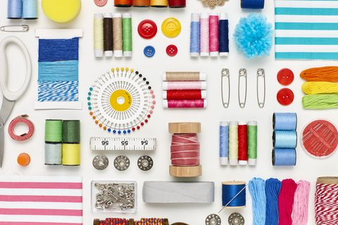 flat lay of various sewing items on white background overhead view of art and craft products arranged side by side multi colored craft materials representing creativity