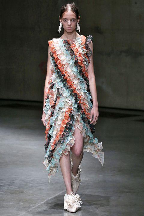 Fashion model, Fashion show, Fashion, Runway, Clothing, Shoulder, Fashion design, Dress, Public event, Event,
