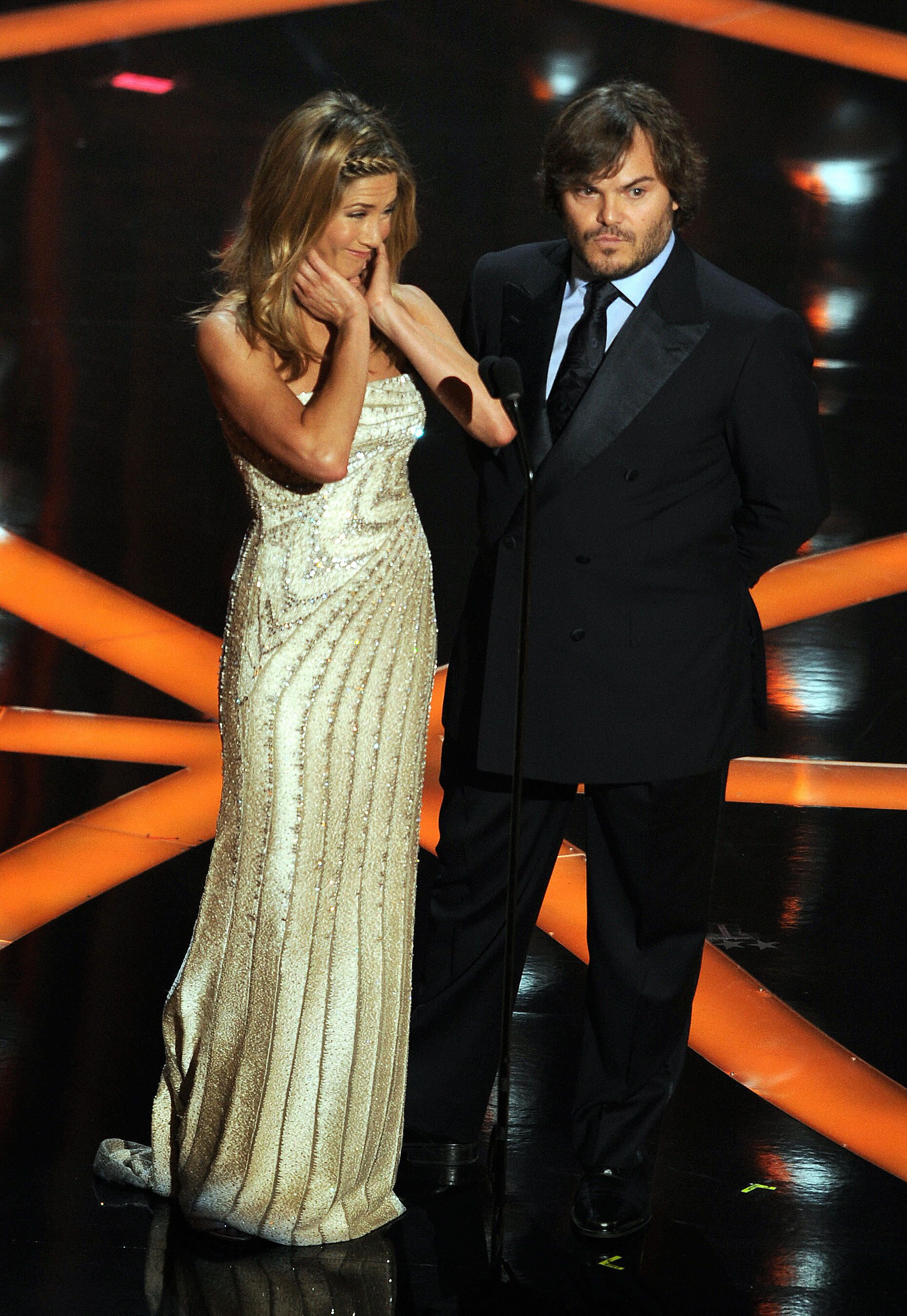 2009: When Jennifer Aniston had to present an award right in front of Brad Pitt and Angelina Jolie. Five years after their divorce, Aniston was forced to present an Oscar right in front of Pitt and his girlfriend at the time, Angelina Jolie—and she was noticeably uncomfortable (as were we) about the whole thing.
