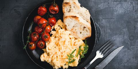 Scrambled eggs and roasted cherry tomatoes