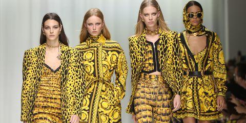 Fashion model, Fashion, Runway, Fashion show, Yellow, Clothing, Fashion design, Event, Model, Haute couture,