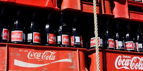 Coca-cola, Cola, Drink, Coca, Product, Carbonated soft drinks, Soft drink, Bottle, Plant,