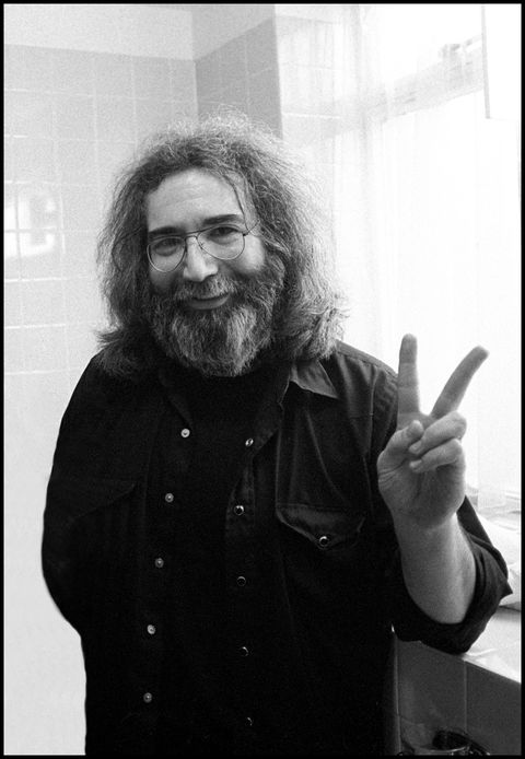 portrait of jerry garcia of the grateful dead doing a peace sign gesture, london, 22nd march 1981 photo by david corioredferns