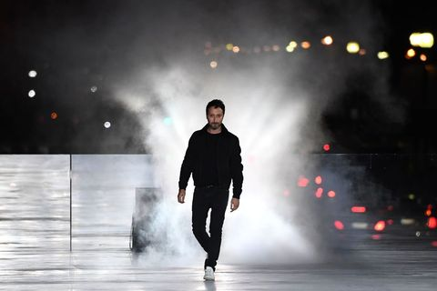 Fashion, Runway, Atmospheric phenomenon, Standing, Water, Human, Darkness, Performance, Fashion show, Sky,