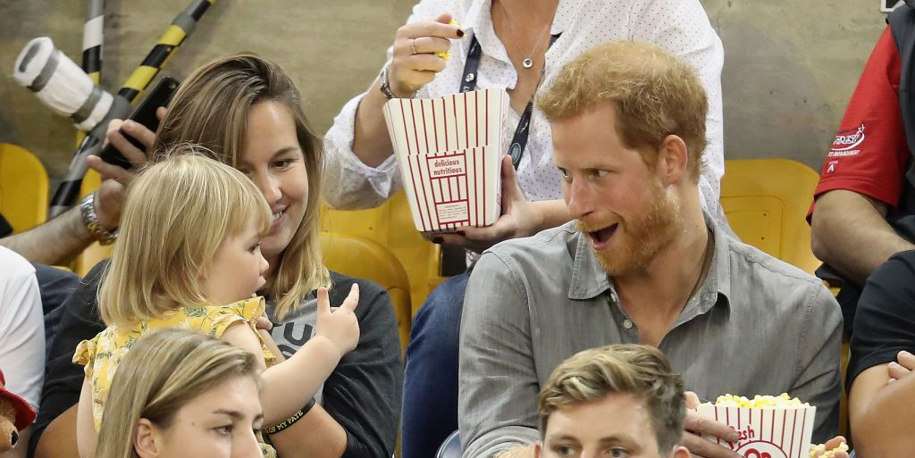 21 adorable photos of Prince Harry with kids just because