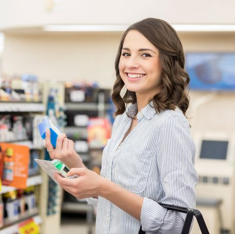 Confident woman shops for allergy medicine in a pharmacy