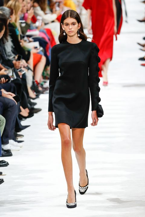 Fashion model, Fashion, Fashion show, Clothing, Runway, Dress, Shoulder, Beauty, Little black dress, Haute couture,