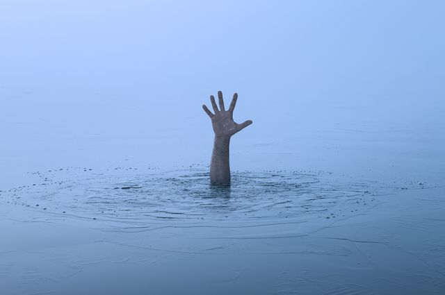 danger, problems concept close up of human hand drowning in the lake