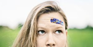 Young Woman With Band-Aid on Forehead