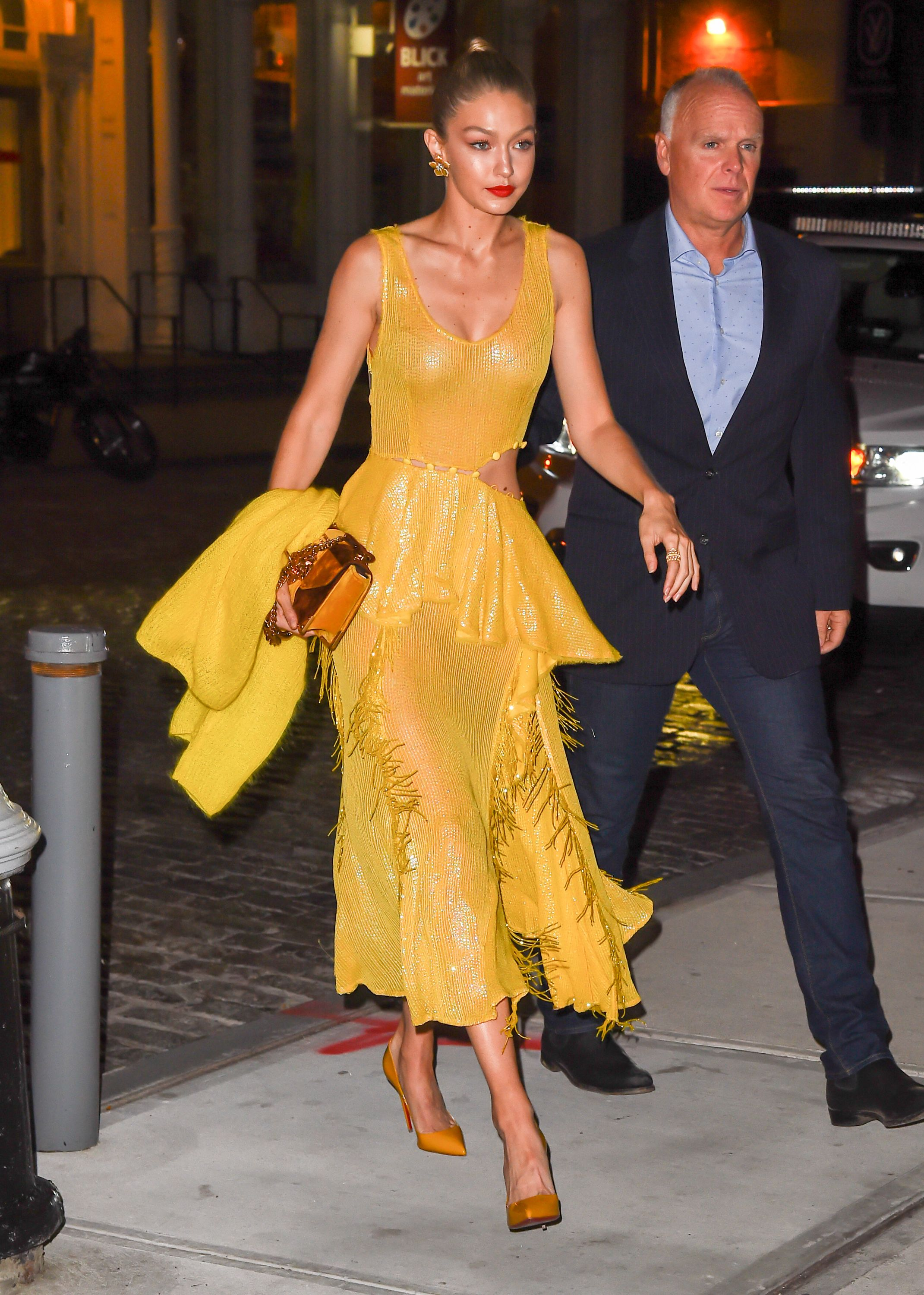October 16, 2017 After modeling a red version of this Prabal Gurung dress on the Spring 2018 runway, Hadid stepped out in a yellow option. The sequin–and–fringe number features a sexy side cutout, making it the perfect red carpet premiere dress (she was on her way to support Blake Lively's film All I See is You ) .
