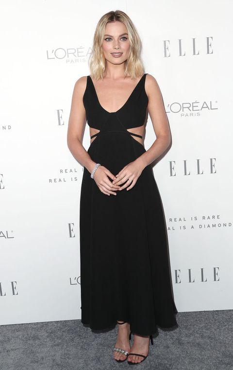 Dress, Clothing, Cocktail dress, Little black dress, Shoulder, Hairstyle, Fashion, Fashion model, Neck, Footwear,