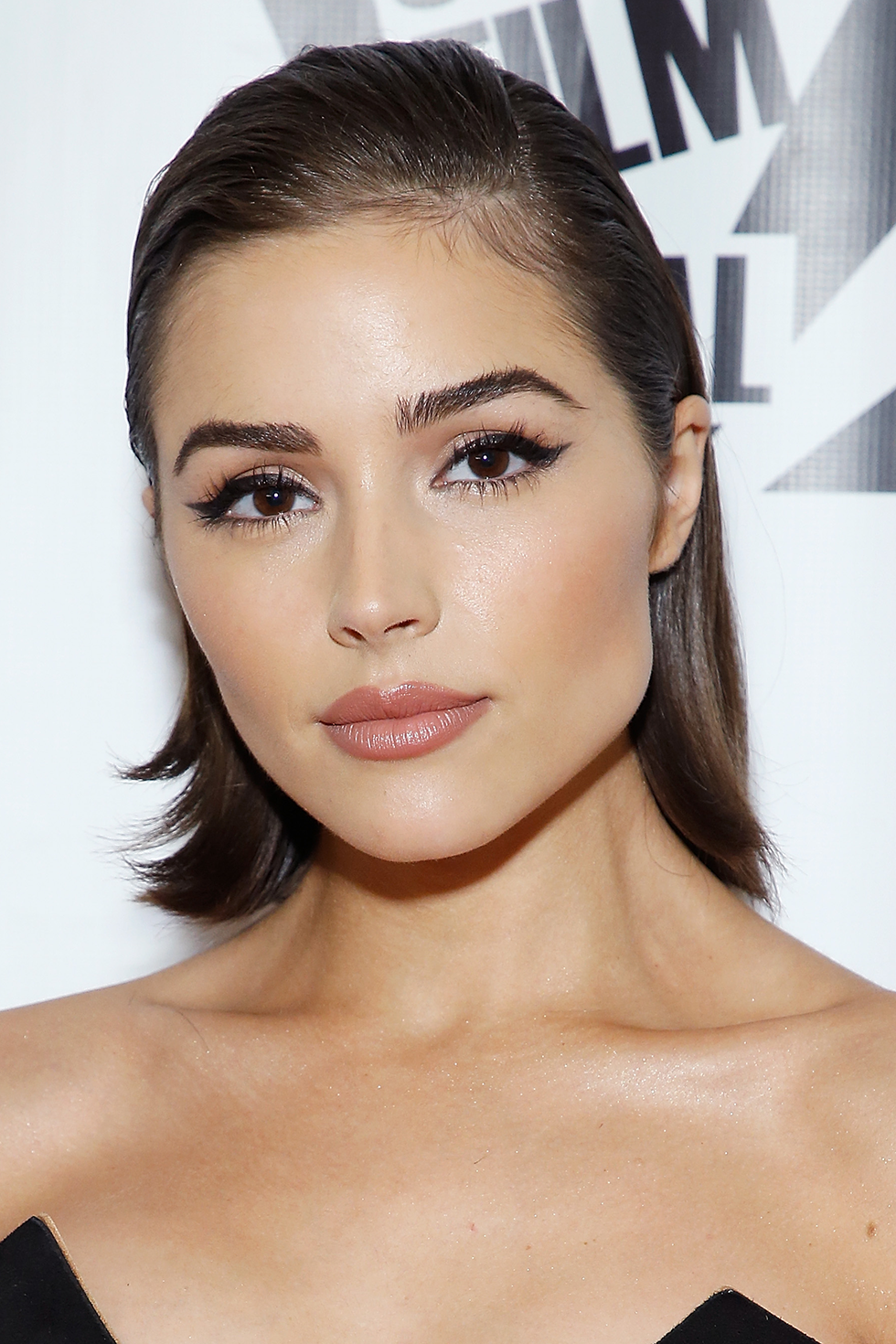Olivia Culpo Life hack: When you don't feel like dealing with your hair, slick it back. Culpo added flair to her glossy lob with faintly flipped ends.