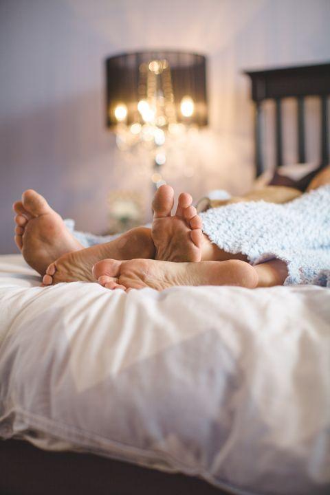 Bed, Bed sheet, Light, Beauty, Room, Leg, Furniture, Comfort, Lighting, Hand,