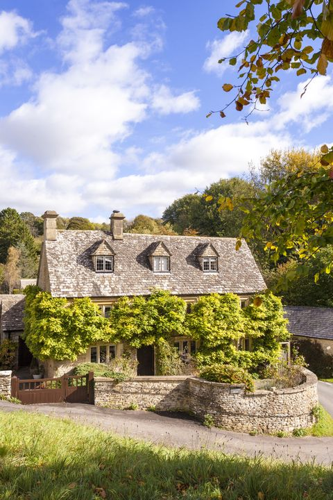 autumn in the cotswold village of duntisbourne abbots, gloucestershire uk