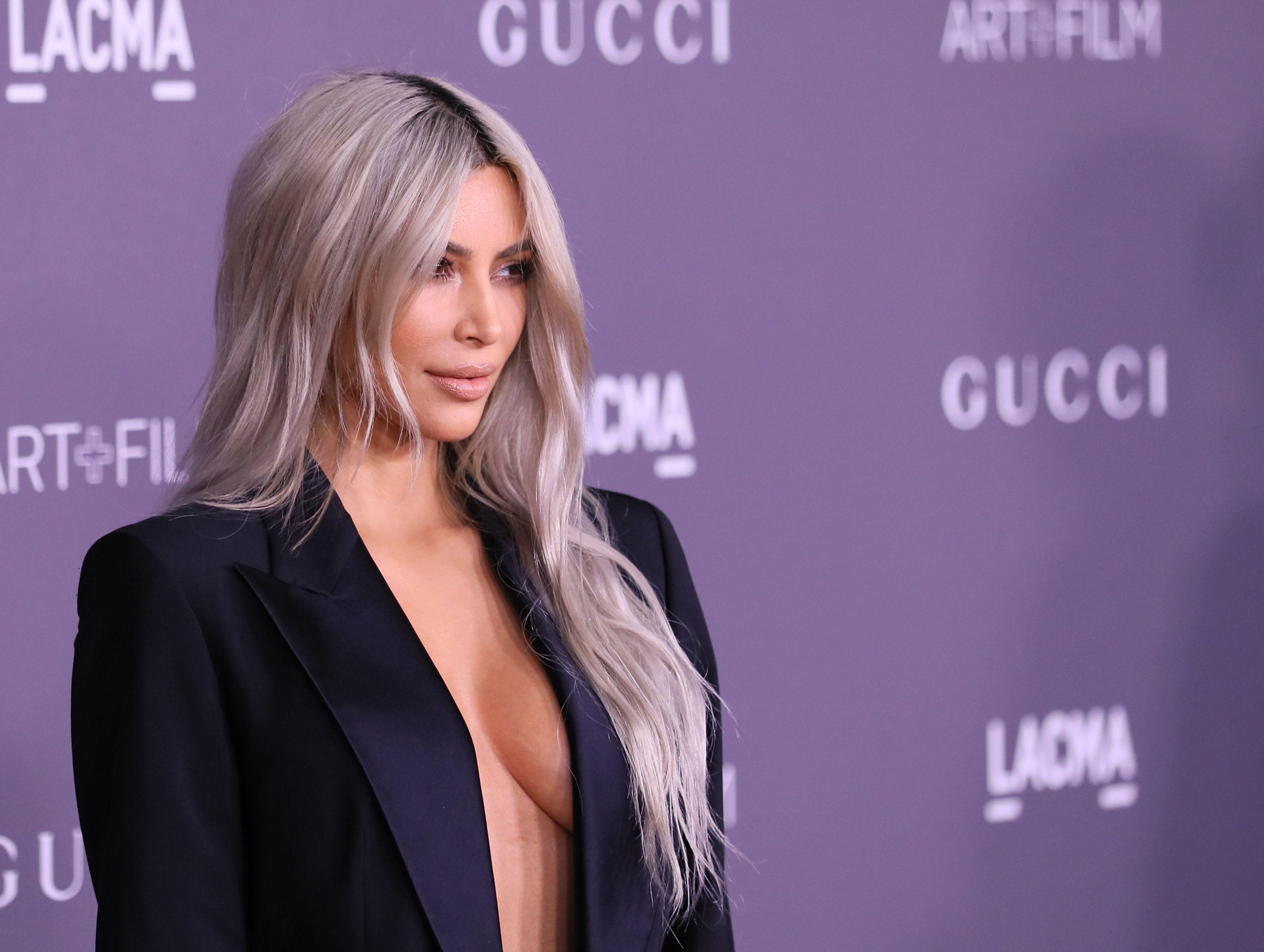 Kim Kardashian Rocks a Gucci Pantsuit Without a Top in L.A.