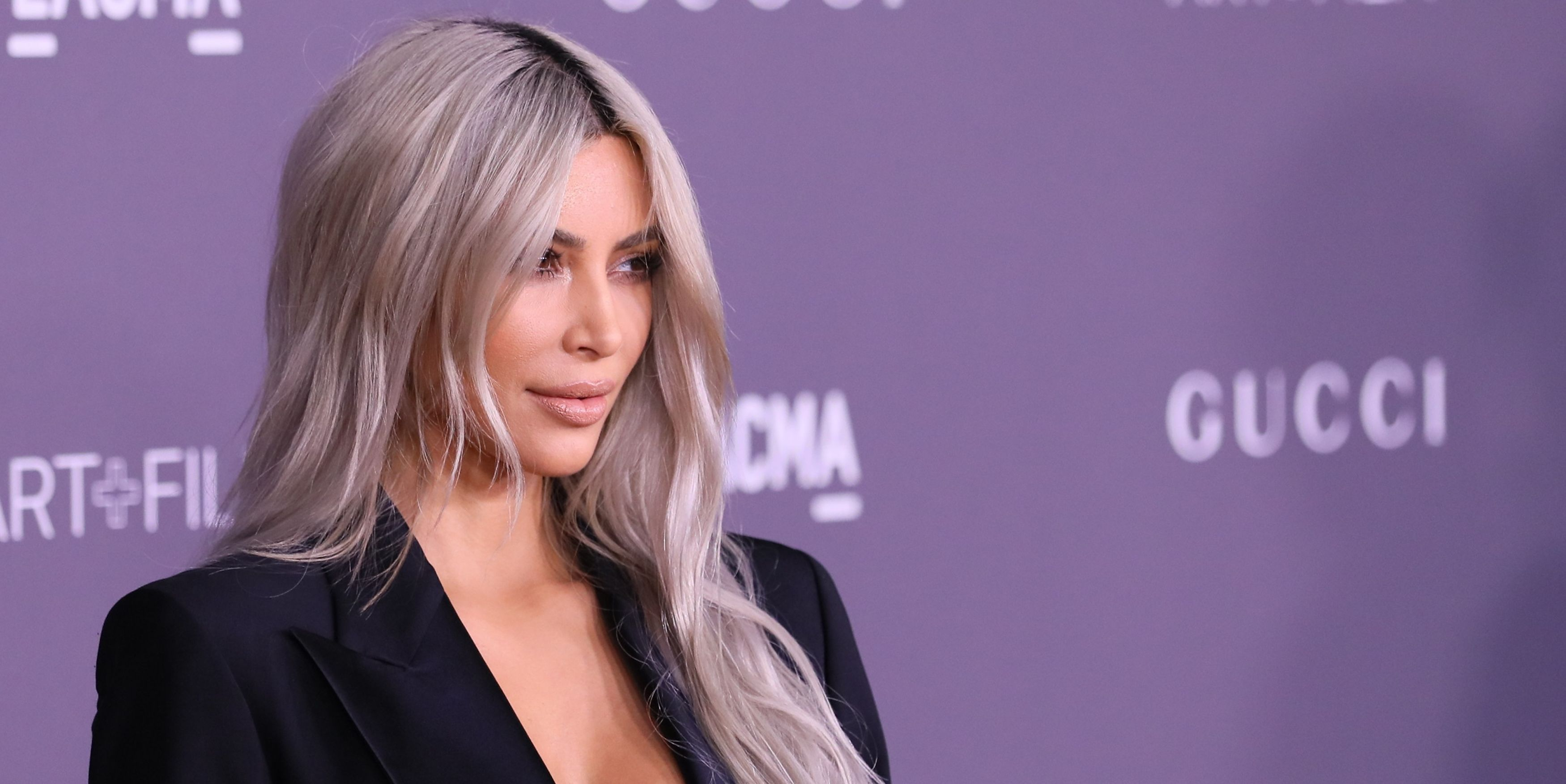 Kim Kardashian Rocks a Gucci Pantsuit Without a Top in L.A.