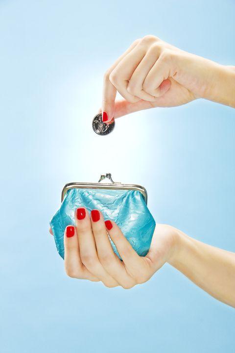 Woman putting quarter in change purse