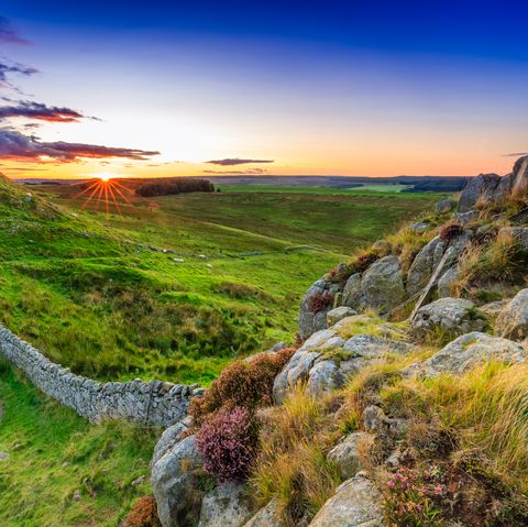 sunset at hadrians wall in northumberland, england