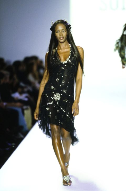 Fashion model, Runway, Fashion show, Fashion, Clothing, Dress, Fashion design, Shoulder, Model, Long hair,