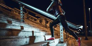 Young woman running at night in a urban city area