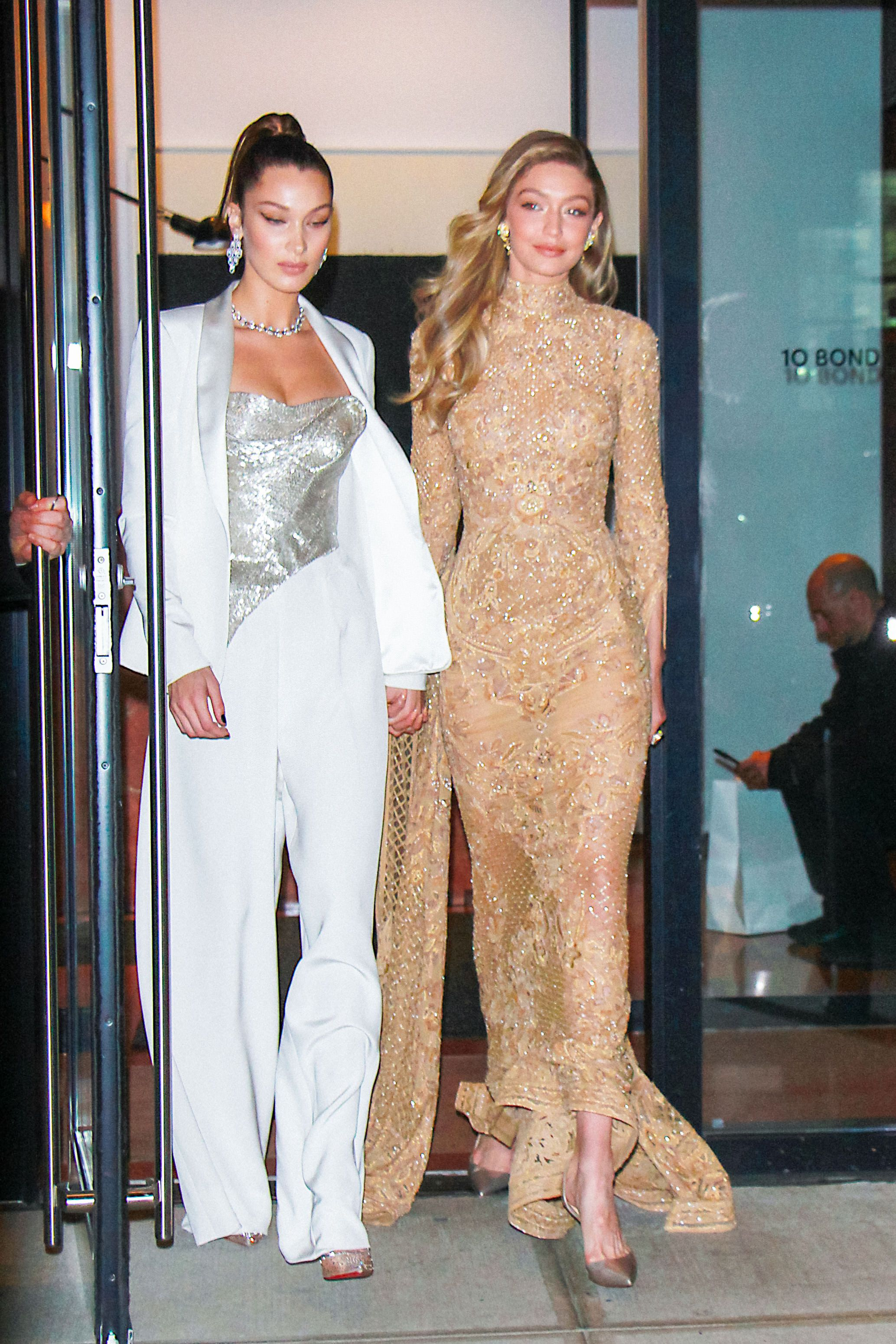November 13, 2017 The Hadid sisters left Gigi's apartment in fancy ensembles for the 2017 Glamour Women of the Year Awards. Gigi wore a Zuhair Murad Couture dress while Bella wore a Cristina Ottaviano bustier and pantsuit set.