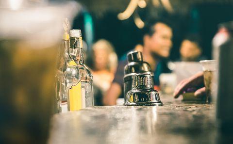 Water, Bottle, Alcohol, Drink, Yellow, Glass bottle, Liqueur, Drinkware, Distilled beverage, Glass,