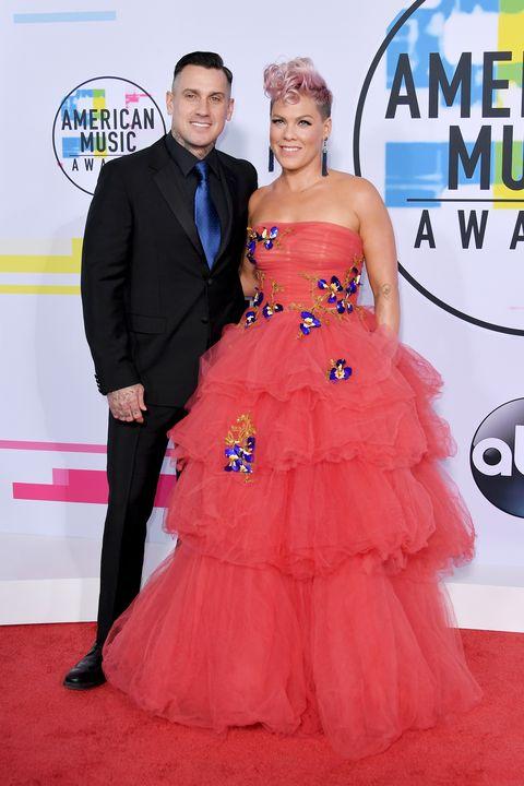 Dress, Clothing, Gown, Carpet, Red carpet, Strapless dress, Shoulder, Pink, Fashion, Flooring,