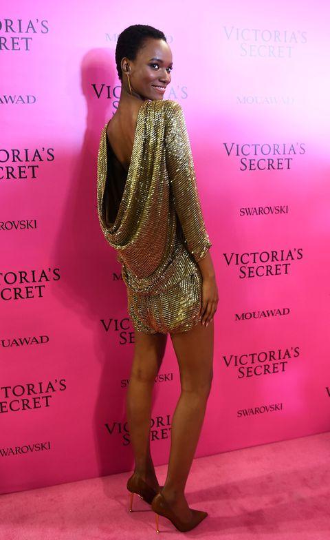 Fashion model, Clothing, Fashion, Beauty, Hairstyle, Pink, Dress, Fashion design, Fashion show, Cocktail dress,