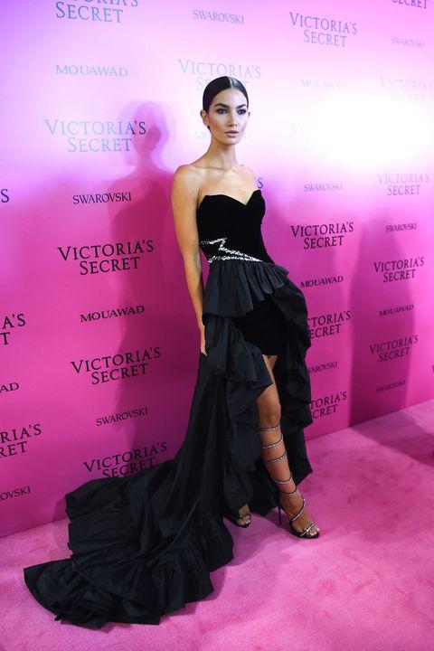 Fashion model, Clothing, Dress, Gown, Fashion, Shoulder, Pink, Strapless dress, Carpet, Formal wear,