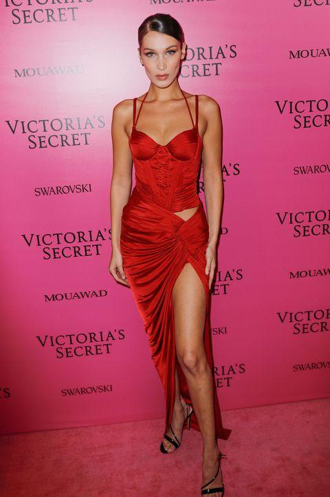 Fashion model, Clothing, Cocktail dress, Dress, Fashion, Shoulder, Leg, Magenta, Fashion design, Fashion show,